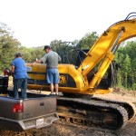 Greg and brother-in-law Randy clearing land.